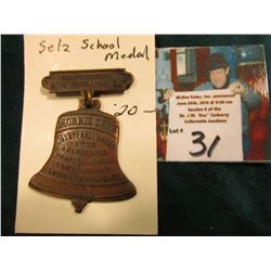 "Brass Badge with Bell-shaped Dangle ""Award for Highest Average"", ""Morris Selz Liberty Bell Medal 177"