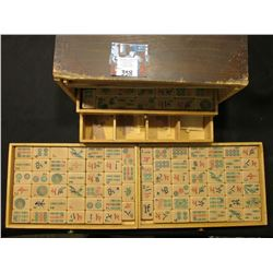 Old Wooden box in poor condition, one brass hinge left intact containing many pieces of a Mahjong se