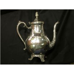 """1883 F.B. Rogers Silver Co."" Coffee Pitcher with attached lid."