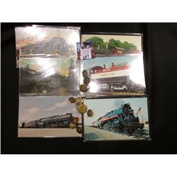 (9) Railroad Metal Buttons, (1) Railroad Tie clasp and (6) Railroad Post Cards.