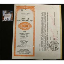 1965 Sanitary Sewage Bond Specimen with (3) pages of Interest coupons from Grand Island, Nebraska. S