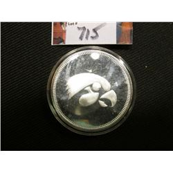 """The University of Iowa/Hawkeyes/One Troy Ounce .999 Fine Silver"", depicts a stylized Hawk head on t"