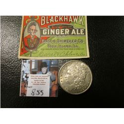 "1897 S Morgan Silver Dollar, EF & an Antique ""Blackhawk Ginger Ale…Rock Island, Ill."" Bottle label."