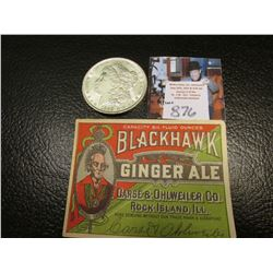 "1889 P Morgan Silver Dollar, AU & an Antique ""Blackhawk Ginger Ale…Rock Island, Ill."" Bottle label."
