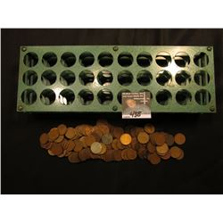 Metal sorting rack for Lincoln Cent Rolls, holds 30 rolls; & a group of (142) Unsorted Lincoln Cents