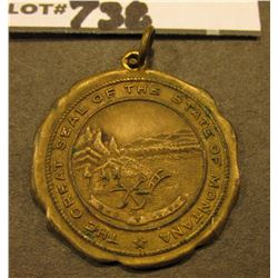 "Brass Pendant. ""The Great Seal of the State of Montana"", ""Warranted/14K/Gold Filled"". scalloped edge"