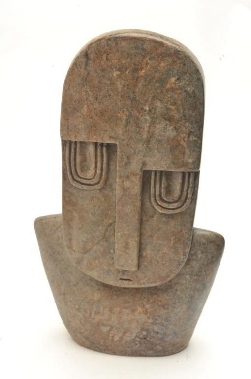 Large carved stone effigy measuring ½ in