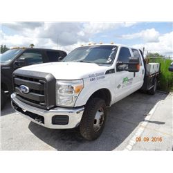 2012 Ford F350 S.D. 4 x 4 9' D.P. Flatbed Crew Cab Truck
