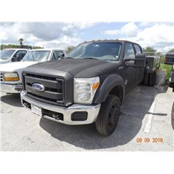 2011 Ford F550 S.D. 4 x 4 12' D.P. Flatbed Crew Cab Truck