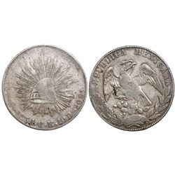 Culiacan, Mexico, cap-and-rays 8 reales, 1854CE, Sonora cap variety.