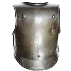 European forged iron breastplate of siege weight, 1700s to early 1800s, with bullet musketball impac