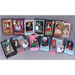 "THIRTEEN FOREIGN 8"" DOLLS IN BOXES"