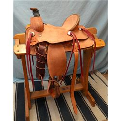 "Morris Saddlery, 12"", junior association, double rig, rough out, rawhide wrapped cantle & horn, bran"