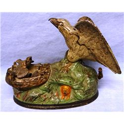 "Eagle and Eagletts vintage mechanical bank, original J & E Stevens, ptd. 1883, 6"" h x 8"" w, green ba"