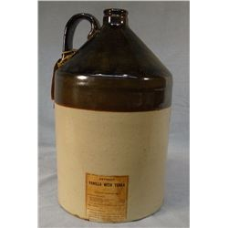 "Stoneware 2 gal. jug w/ Park & Davis original label, ""Vanilla.""  With tag: ""Empty jug must be retune"