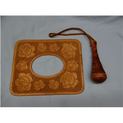 Flower tooled leather picture frame and leather bound sap, Al Furstnow basement, Miles City, MT