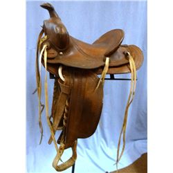 "Miles City Saddlery saddle, #600, 14"", marked 92 42 behind cantle"