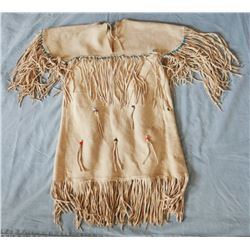 Sioux child's deerskin dress, Northern Plains, brain tanned, turquoise beads, ca. 1915-1940