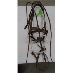 Crockett silver mounted bit on early tooled headstall