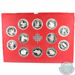 12x 1867-1967 Canada Confederation Sterling Silver Medallions in Red Cardboard Display. Each coin is
