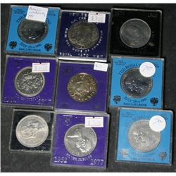 Collection of 9 Foreign Coins in Hard Plastic Cases