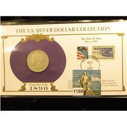 1890 O Morgan Silver Dollar In US Silver Dollar Collection Binder; c/w Commerative Stamp F-12