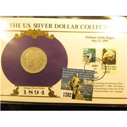 1894 O Morgan Silver Dollar In US Silver Dollar Collection Binder; c/w Commerative Stamp     F-12