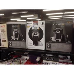 FOUR KEURIG COFFEE MACHINES
