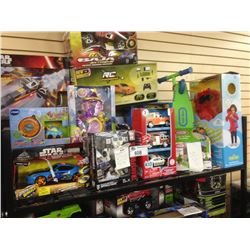 SHELF LOT OF ASSORTED TOYS INCLUDING STARWARS, RC BAJU, ELMO, VETCH ETC.