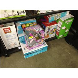 SHELF LOT OF ASSORTED TOYS INCLUDING PLAYDAY TOOL BENCH, SMART TRIKE, FISHER PRICE, ROLLER BLOCKS,