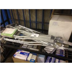 SHELF LOT OF CRUTCHES AND MEDICAL EXAM DRAPES