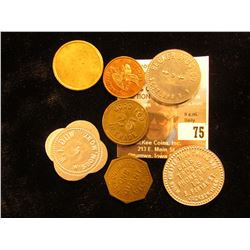 Plastic case with (7) various tokens including a Creamery Token.