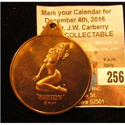 "Uniface Bronze Pendant 38 mm depicting a nude ""Marilyn Monroe"" copyright ""Col. Mint""."