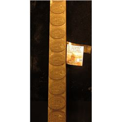 """Wooden block with ten identical rubber stamps for """"First National Bank Bessemer, Alabama""""."""