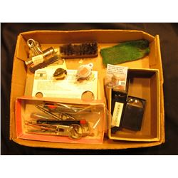 Metal Clip; several magnifying glasses; Wire brush; (3) Compasses; Coin holders, and misc.