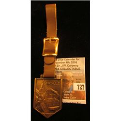 """Insley"" Brass Watch Fob. (Depicts an excavator). Complete with leather strap. Excellent condition."