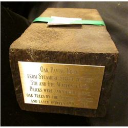 "Oak Paving Brick with brass plaque engraved ""Oak Paving Brick From Sycamore Street, Between 5th and"