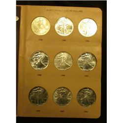 Dansco World Coin Library Album containing a Complete Set of U.S. American Eagle One Ounce .999 Fine