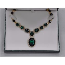 """Ladies Custom Necklace, 218 Emerald Green and Clear Swarovski Elements = 198cts. 18-21"""". SRRV: $475."""