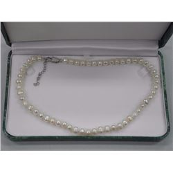 """Ladies Freshwater Pearl Necklace Choker 16"""" Length, 7 x 7.5mm. SRRV: $1,180.00."""
