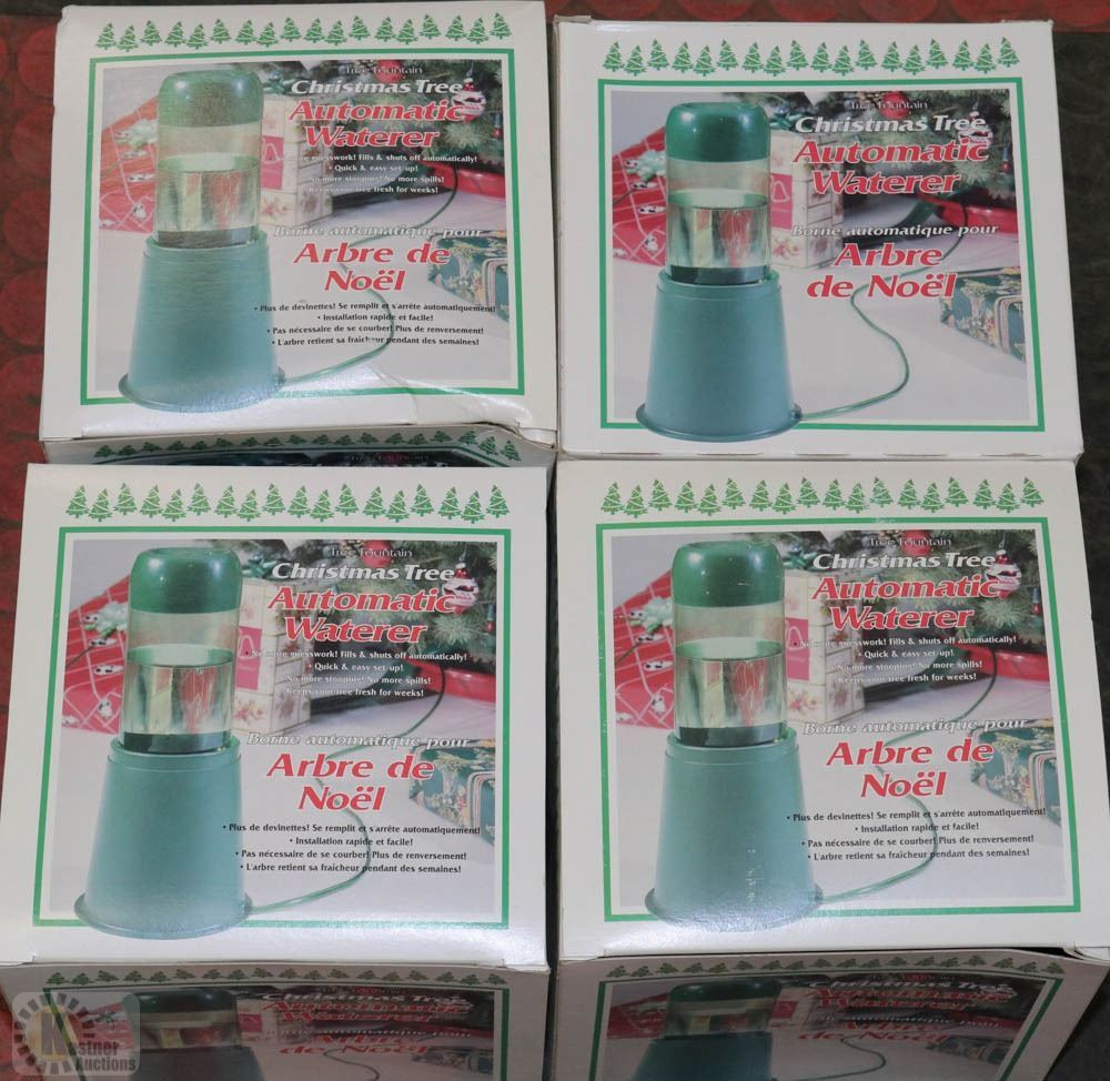 A Group Of 4 Automatic Christmas Tree Waterers