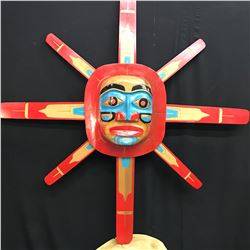 LARGE VIBRANT PORTRAIT SUN MASK WITH 8 RAYS, ARTIST UNKNOWN.