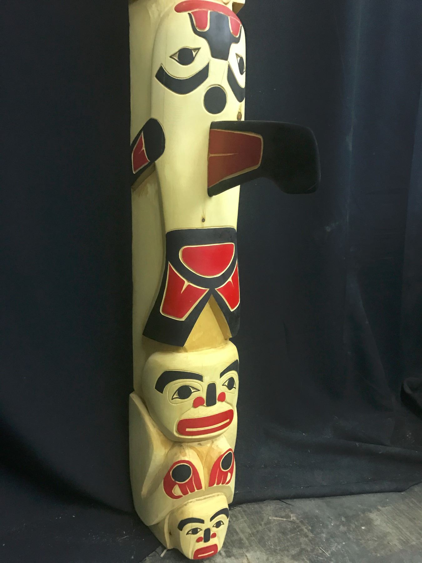 totem pole with eagle killer whale and frog chief with family