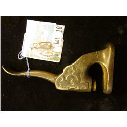 Cast Iron Button Press, which 'Doc' valued at $69.00.