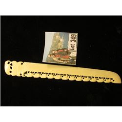 "Ivory Letter Opener with Elephants following elephants ornate carvings. 7""."
