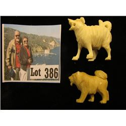 Pair of Carved Ivory Dogs.