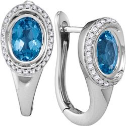 0.25CT Diamond and 0.75CT Blue Topaz Anniversary 14KT Earrings White Gold