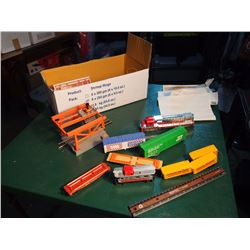 Box Of Train Pieces And Parts