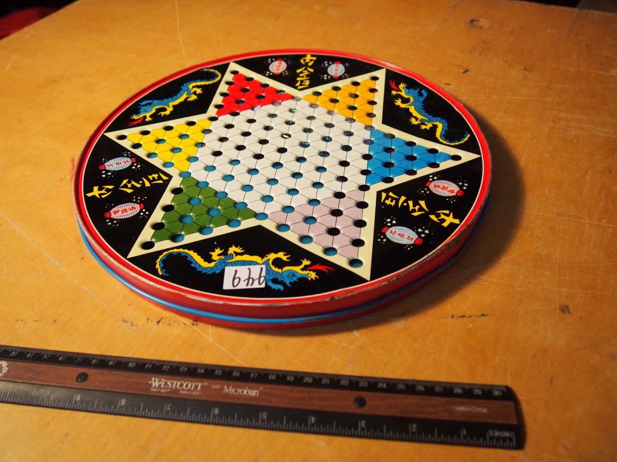 how to win chinese checkers triangle