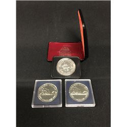 3 COMMEMORATIVE CANADIAN DOLLAR COINS, 1886-1996 VANCOUVER X2, AND 1875-1975 CALGARY COIN IN CASE